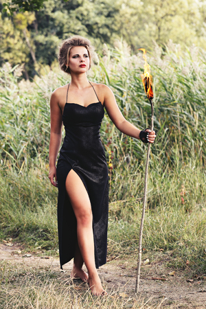 torches: women are holding with torches in the forest