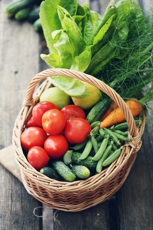 fruits in a basket: Healthy food background. photo of different vegetables in big basket