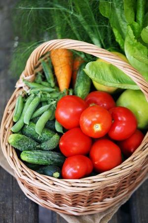 food basket: Healthy food background. photo of different vegetables in big basket