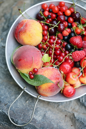 sieve: garden organic berries and fruits on a sieve Stock Photo