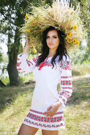 Beautiful woman in a national Ukrainian suit and wreath. Kupala Night concept