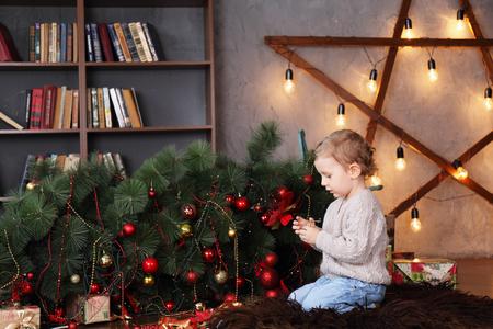 boy near a fallen Christmas tree. Christmas concept
