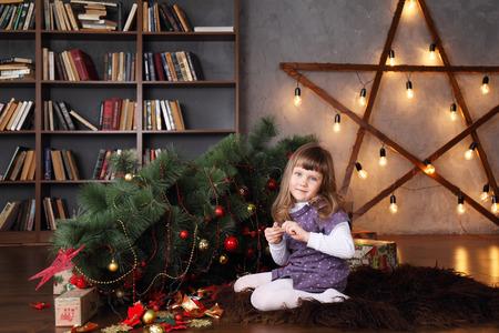 girl near a fallen Christmas tree. Christmas concept