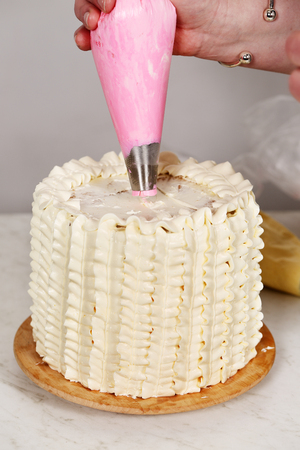 Decorating a cake Stock Photo