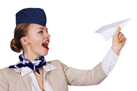 Air hostess holding a paper airplane