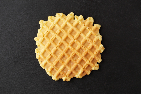 Ruddy wafer on a plate of slate
