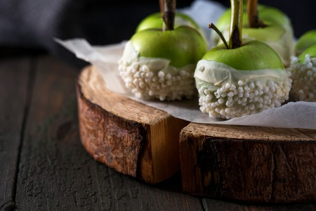 Apples in white chocolate glaze, close-up