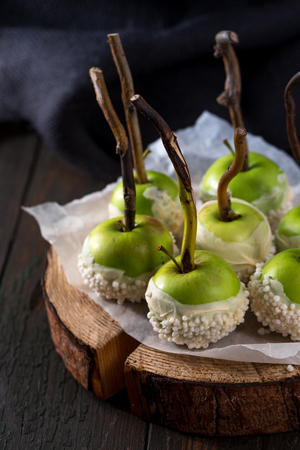 Green apples in chocolate