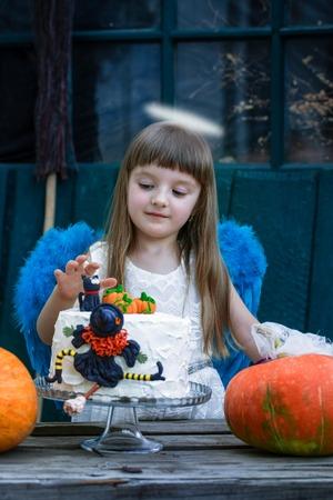 Angel and birthday cake