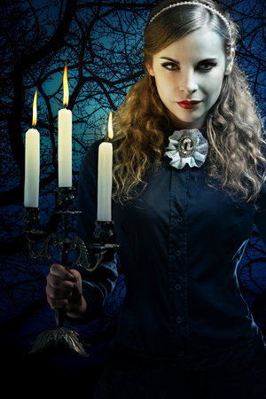 witch in a gothic dress Stock Photo