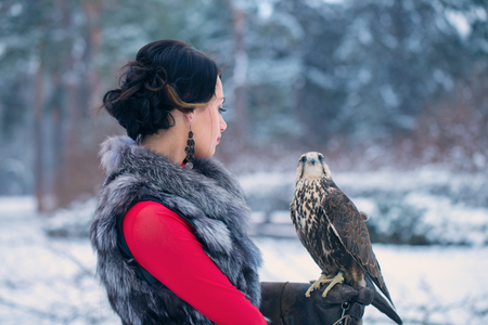 Beautiful woman and falcon Stock Photo