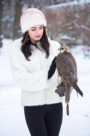 Beautiful woman and falcon Stock Photo