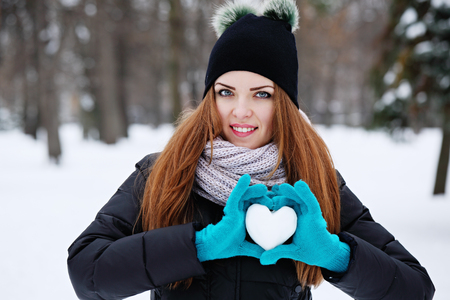 woman holds a heart