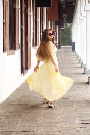 woman in a long dress dancing Stock Photo