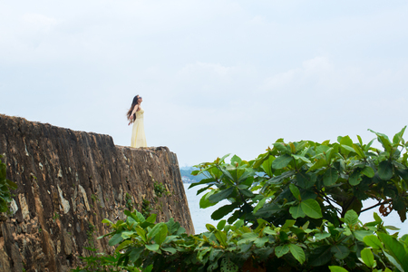 Woman on the edge of the wall