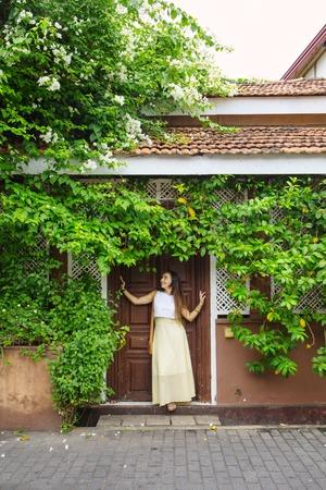 woman standing near doors