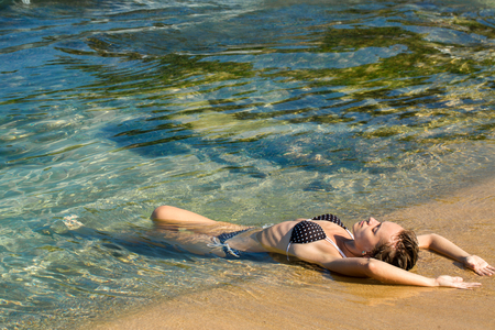 woman lies in the water, top view Stock Photo