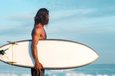 Surfer near the Indian Ocean Stock Photo