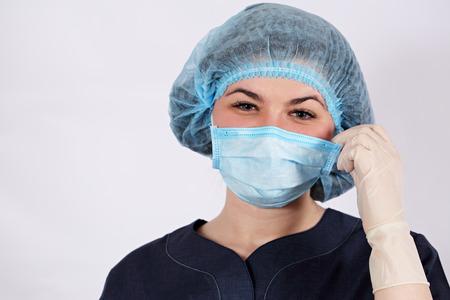 nurse puts a protective mask
