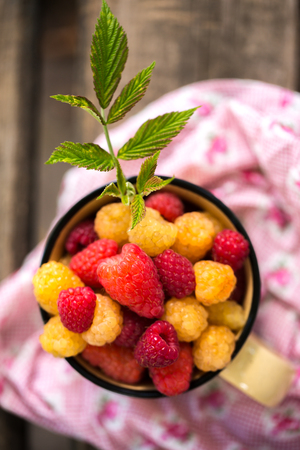 sweet red and yellow raspberries Stock Photo