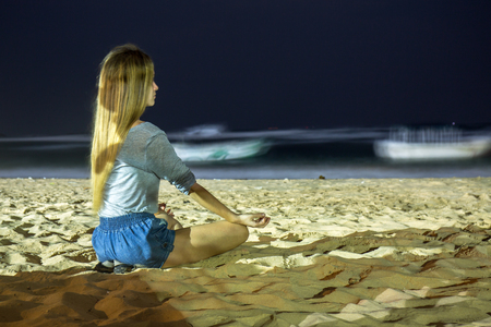 The girl looks at the ocean