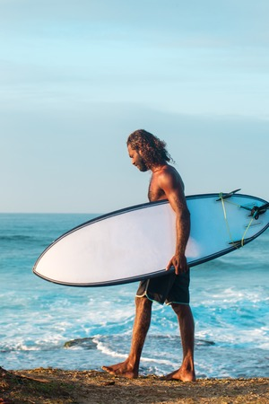 Surfer on the shore Stock Photo