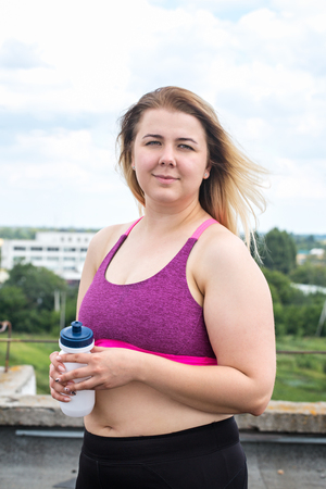sportswoman with a bottle of water Stock Photo