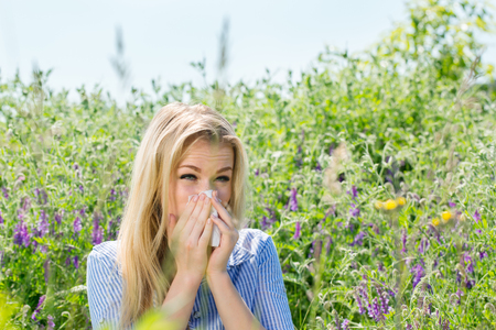 girl suffering from seasonal allergies Stock Photo