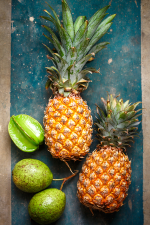 Pineapples and tropical fruits Stock Photo
