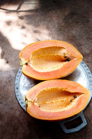 Ripe papaya without seeds cut into two halves
