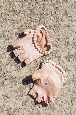Beautiful, stylish, pink, leather gloves with pearls