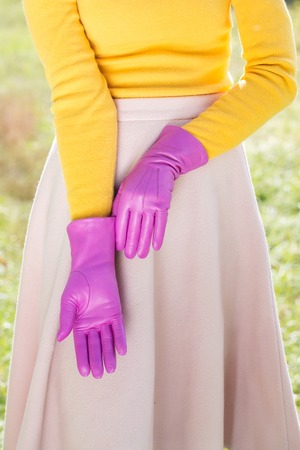 Woman in a pink gloves