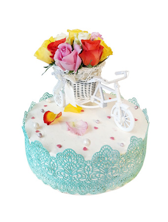 The cake with a model of a bicycle with flowers