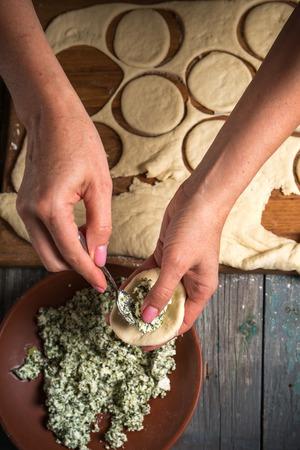Woman puts stuffing