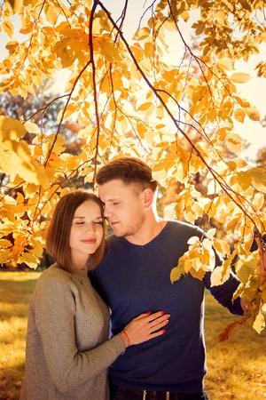 romantic couple under an autumn tree