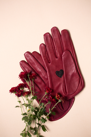 Beautiful burgundy leather gloves with flowers