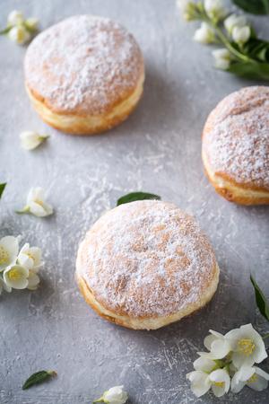 berliner donuts in powdered sugar Stock Photo
