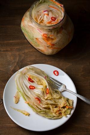 Kimchi on wooden background