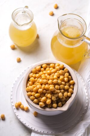 Boiled chickpeas and aquafaba, vegetarian healthy product Stock Photo