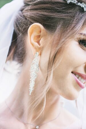 Young beautiful girl in wedding dress and veil