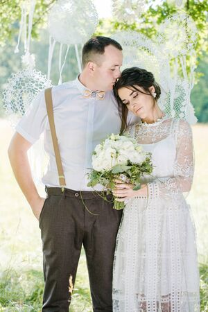Wedding of a young beautiful couple in vintage style. Closeup portrait of a young happy newlywed couple Stock Photo