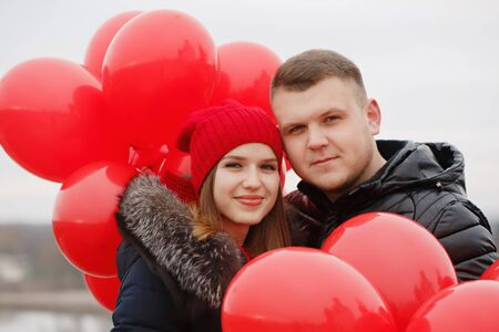 portrait of a beautiful young couple with red balloons. The concept for St. Valentine's Day Foto de archivo - 138047417