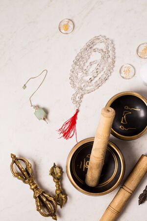 Pendulum, singing bowls and other healing tools for healing in Reiki stream on a white background Imagens