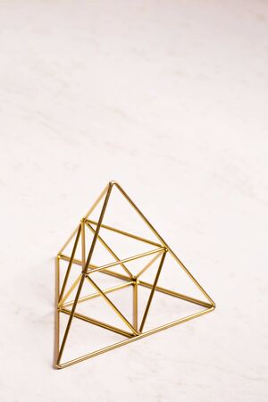 golden pyramid of wishes on a white background