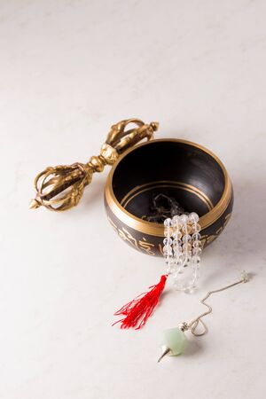 Pendulum, singing bowls and other healing tools for healing in Reiki stream on a white background Archivio Fotografico