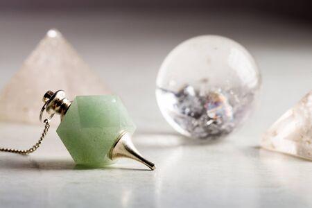 crystal ball, rock crystal pyramid and Pendulum, Reiki concept