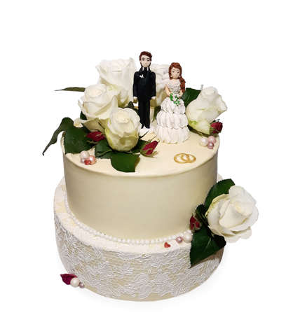 White wedding cake with figures of bride and groom