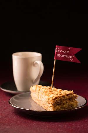 Morning herbal tea with a slice of delicious napoleon cake Archivio Fotografico