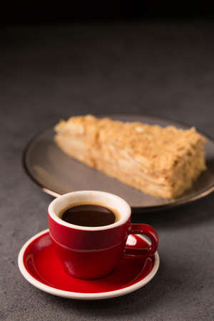 coffee expresso in a red coffee cup with a slice of delicious napoleon cake Stock fotó