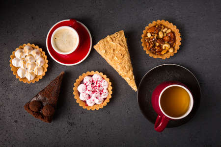 Collection of delicious desserts on gray background, top view